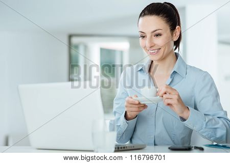 Smiling Woman Watching A Video On Her Laptop
