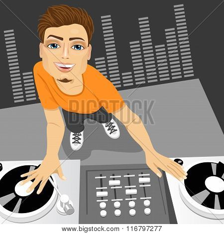 male disc jockey mixing the track using his turntables
