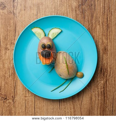 Funny Hare Made Of Potatoes On Blue Plate
