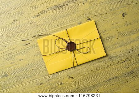 Letter with seal on table