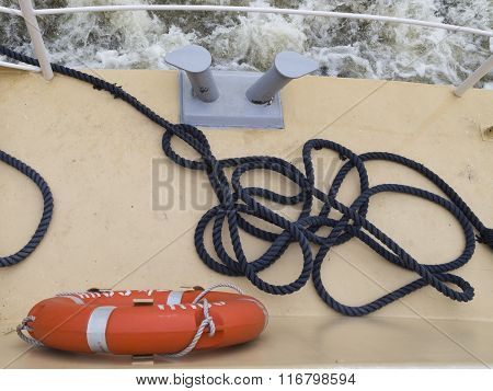 Rope And Life Preserver On Deck