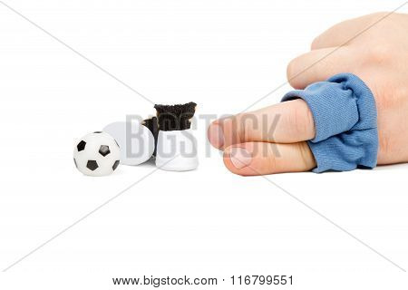 Soccer Player With The Ball Lying Near