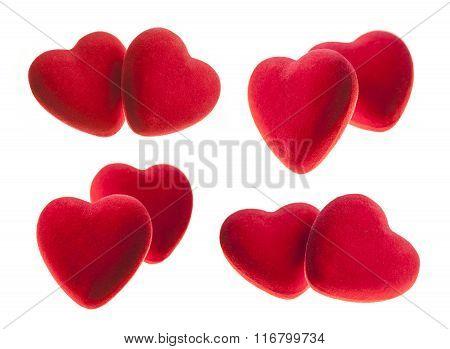 Red velvet hearts isolated on white background.