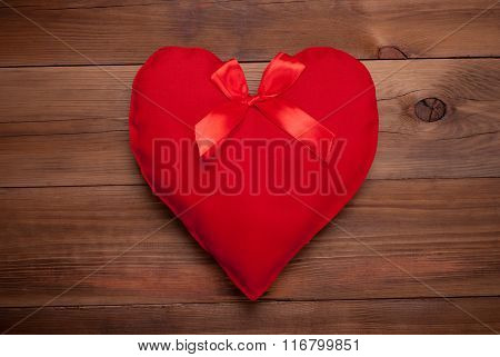 Red Heart With A Bow On A Wooden Background.