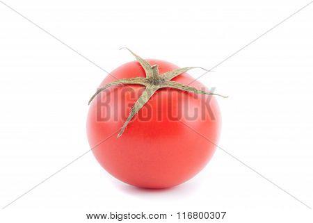 Ripe Tomato Closeup On A White Background.