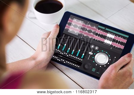Woman using tablet pc against music app
