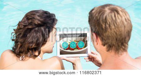 Food app against couple using digital tablet