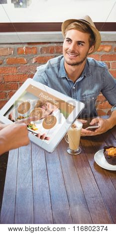 Waitress taking handsome hipsters order with tablet against food app