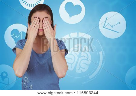 Pretty brunette with hands over eyes against chemical structure in blue and white