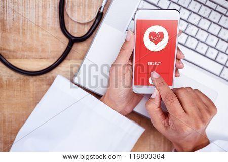 Medical app against doctor using smartphone on wooden desk