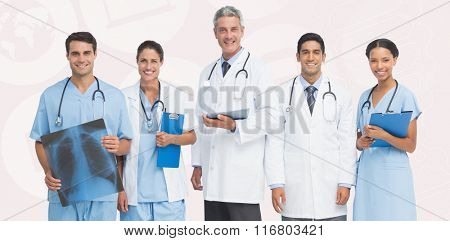 Portrait of confident medical team against beige