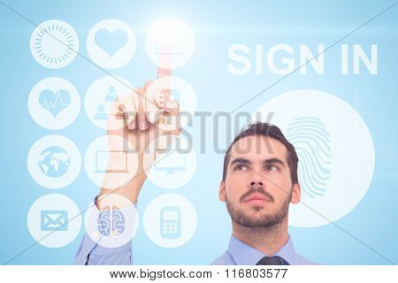 Businessman in shirt pointing something up against blue background