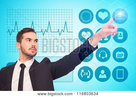 Thoughtful businessman pointing his finger against chemical structure in blue and white