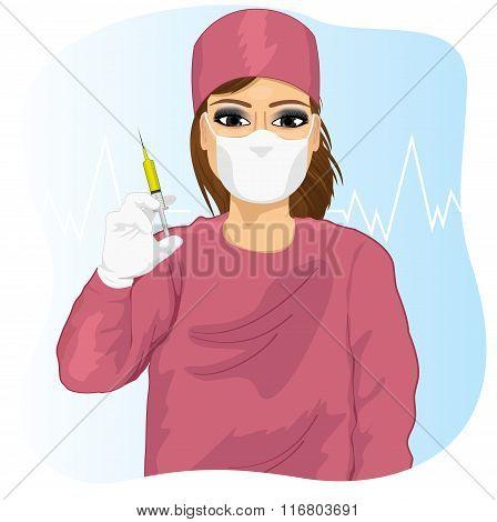 Female doctor in face mask holding a syringe