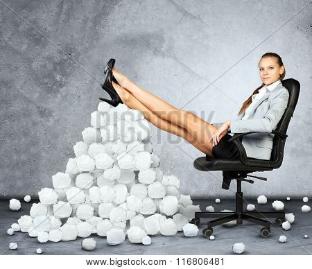 Businesswoman and pile crumpled paper balls