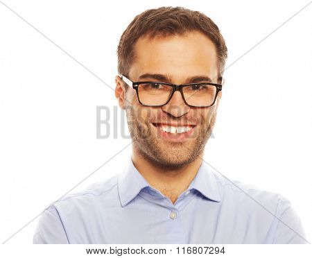 business, successful and people concept - Handsome young business man in blue shirt looking at camera standing against white background