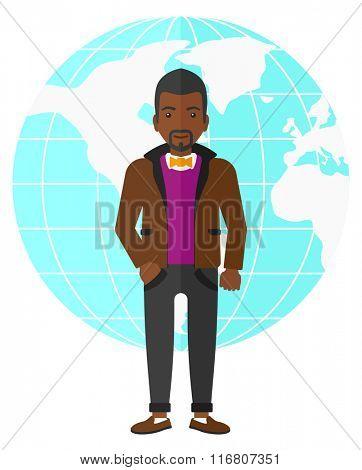 Businessman standing on globe background.