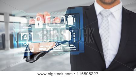 Businessman showing his smartphone screen against modern room overlooking city