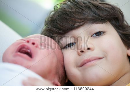 Newborn baby with his older brother