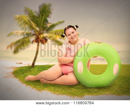 Plus size woman enjoying holidays on the beach. Warm filtered picture.