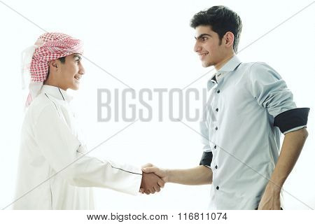 Two Arabic kids meeting