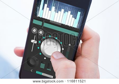 Woman using her mobile phone against music app