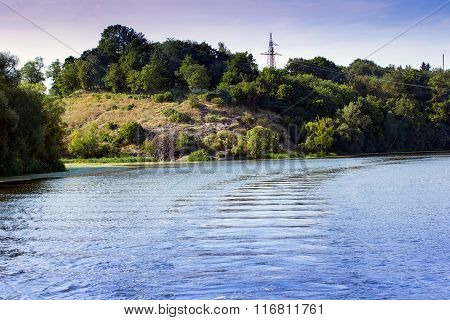 River Around Coastline Of Hills With Green Trees