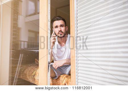 Focused Man Talking On The Phone