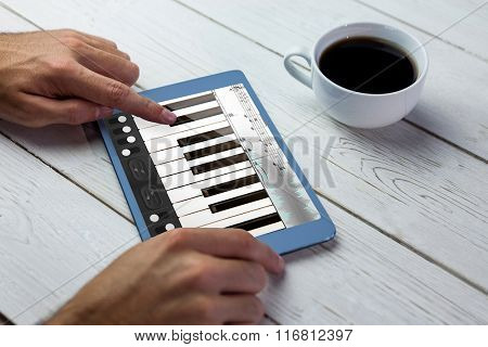 Music app against person using tablet on wooden table