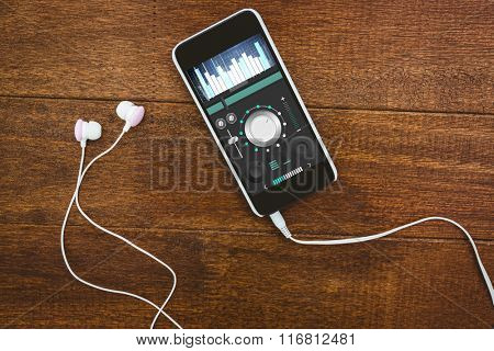 Music app against view of a black smartphone with white headphones