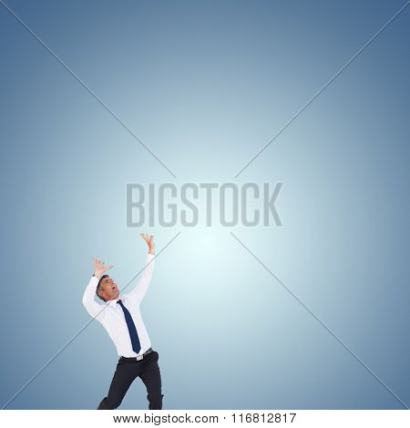 Businessman with hands raised on white background against purple vignette