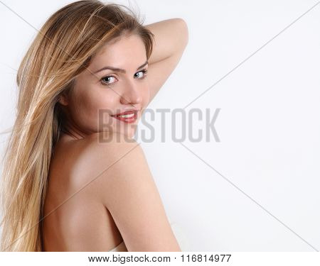 Spa Portrait Of Smiling Blonde Woman Over The Shoulder