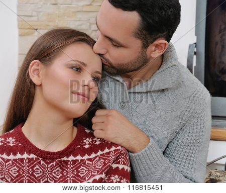 Young Happy Couple On The Background Of Fireplace