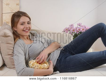 Young Woman Spending A Relaxing Weekend At Home