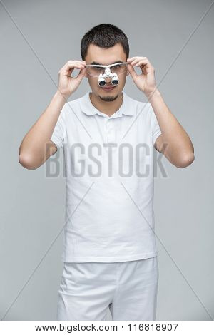 Doctor with binocular loupes