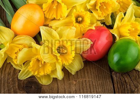 Yellow daffodil flowers with Easter eggs