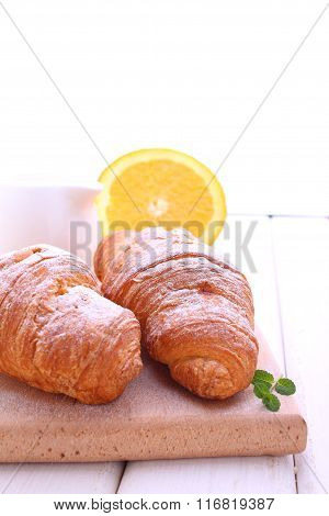 Croissants For Breakfast On A Cutting Wooden Board