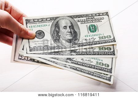 Dollars Banknotes In Hand, Close Up