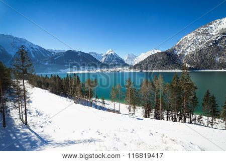 Mountain lake winter landscape in the Alps, Achen Lake Austria, Tirol