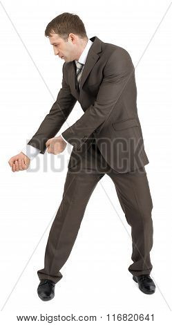 Businessman holding invisible axe