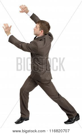 Businessman holding invisible thing