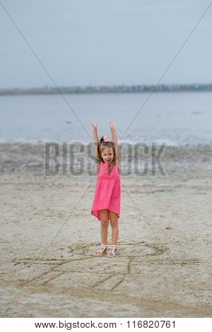 Little Girl Playing At The Summer Beach