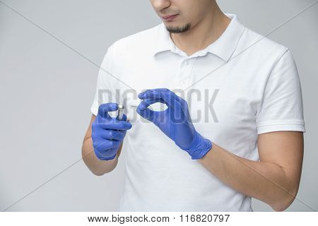 Dentist with dental handpiece