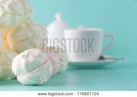 Sweet Pastel Colored Marshmallow And Cup Of Coffee On Aquamarine Background