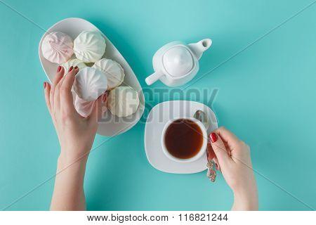 Women Pick Pastel Colored Marshmallow