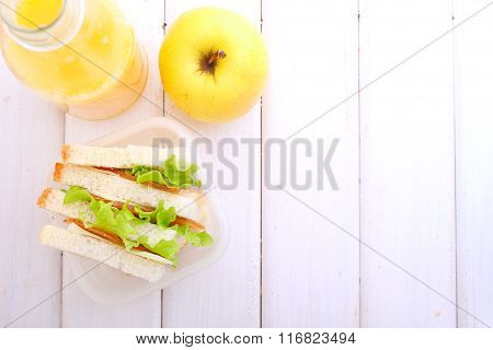 Lunchbox With A Sandwich, An Apple And A Bottle Of Juice For A Snack
