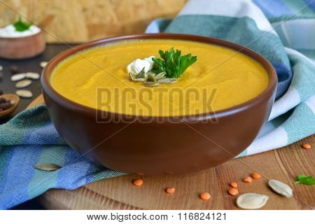 Pumpkin cream soup, with lentils and cream cheese