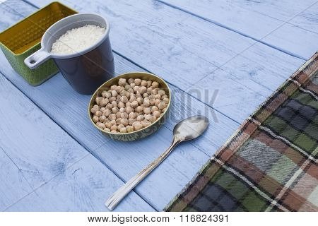 Figure Chickpeas And Spices On A Wooden Background
