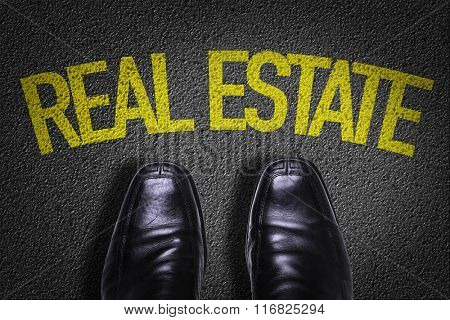 Top View of Business Shoes on the floor with the text: Real Estate