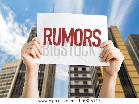 Rumors placard with urban background